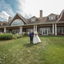 bride and groom by the clubhouse
