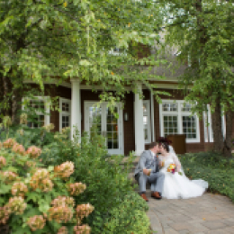 bride and groom in greenery