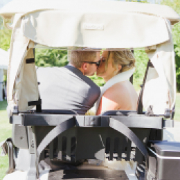 bride and groom in cart